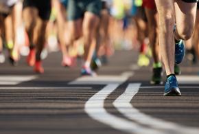 Runners legs on black pavement