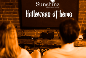 Couple watching a TV screen with Halloween at Home